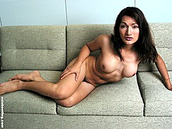 Lying Naked On Couch Hand On Right Thigh Thighs Pressed Together Firm Asian Ladyboy Tits Bare
