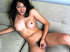 Asian Shemale Playing With Cock On Sofa Stroking Shemale Cock
