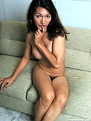 Sitting On Sofa Arm Covering Breasts Biting Finger
