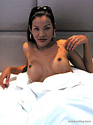 Lying In Bed Small Brown Nipples On Upturned Breasts