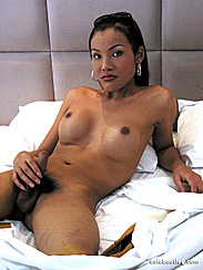 Asian Shemale Porn Playing With Cock In Bed Hand Resting On Covers Legs Spreading
