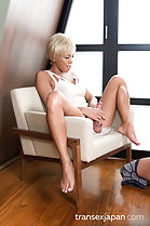 Masturbating seated on chair legs spread bare feet