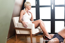 Looking down sitting on chair wearing high heels giving footjob