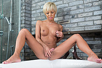 Blonde Miran Sitting On Edge Of Bath Playing With Her Cock