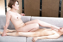 Seated on sofa teasing with bare feet