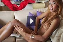 Blonde Asian Shemale Moo Sitting On Couch